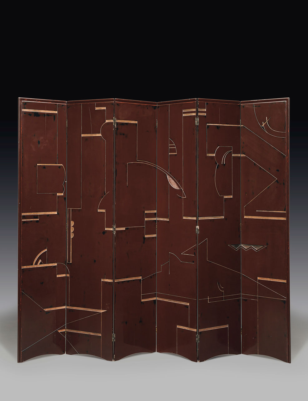 Installation image of a six-panel burgundy screen with gold geometric designs.