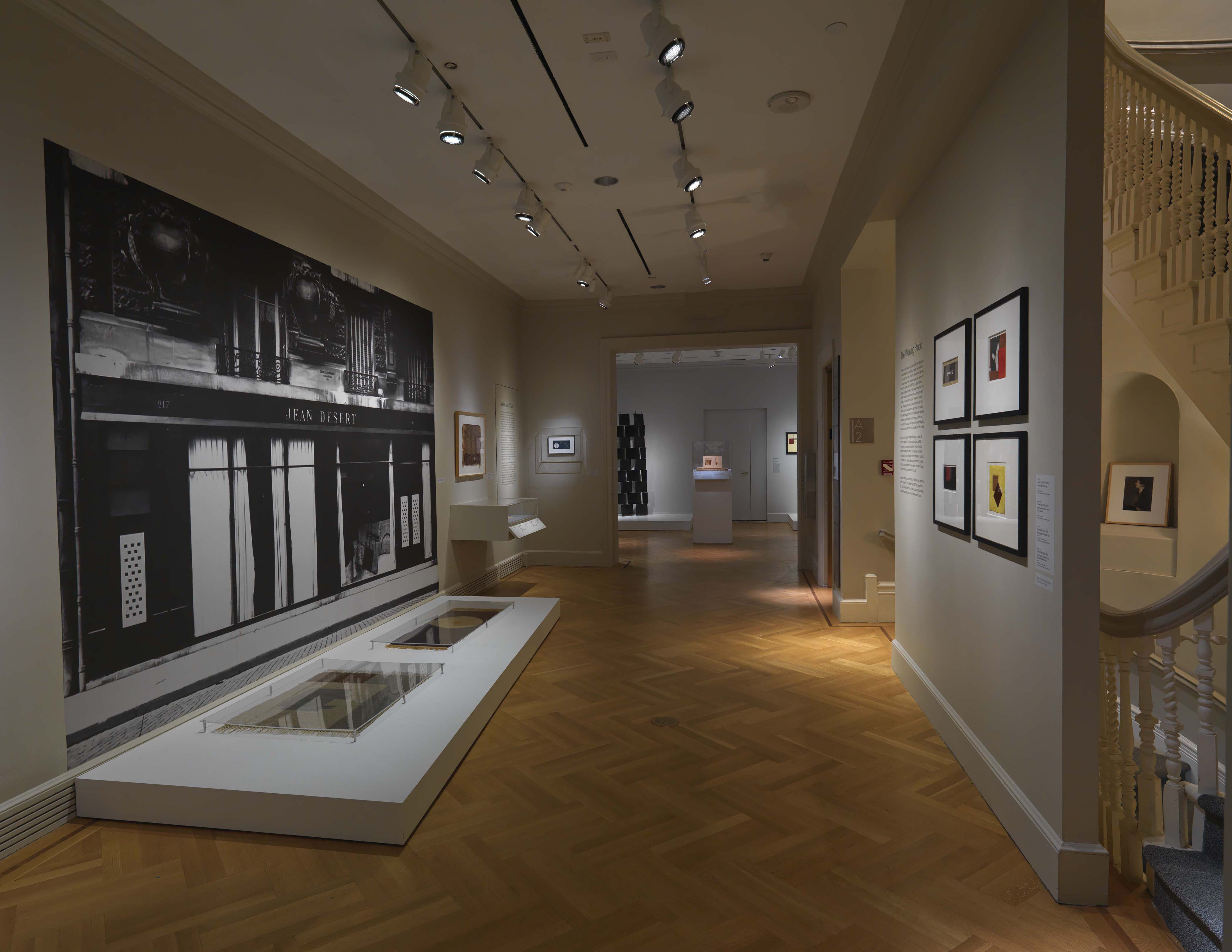 Bard Graduate Center's Eileen Gray exhibition installation with carpets, paintings, and an architectural model on display.