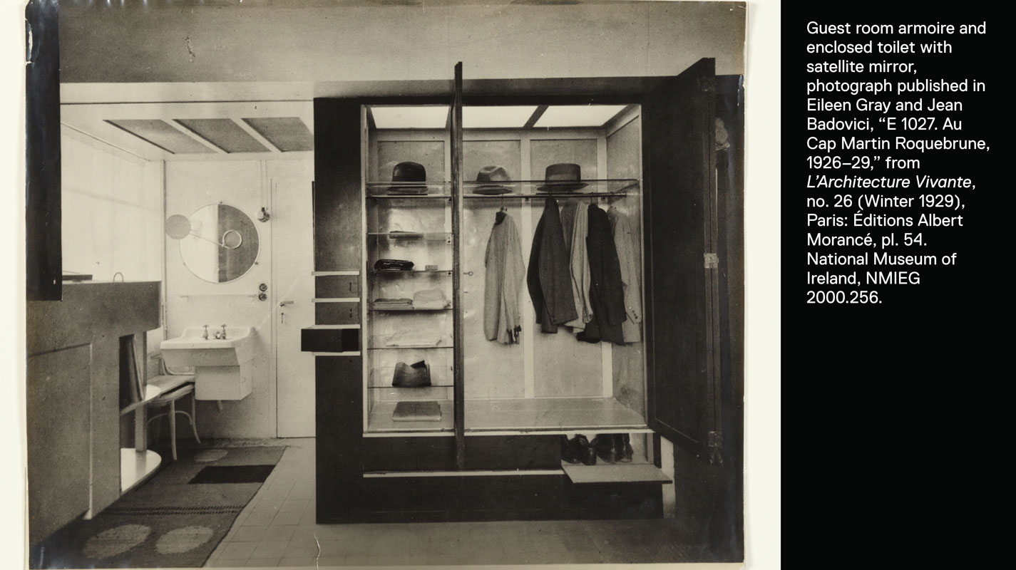 Armoire open revealing shelves of clothing next to a sink and the Satellite mirror.